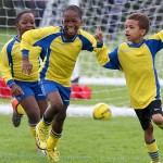 Celebrating a goal at Kings College Junior School football tournament